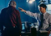 С Лиамом Нисоном на съемках фильма «Человек Тьмы» (1990)